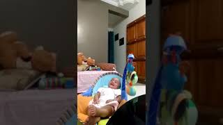 Cute baby laughing so hard