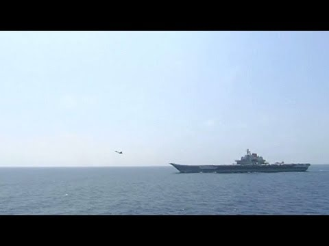 Xi Jinping inspects fleet in China's largest ever naval review