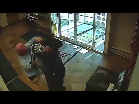 Surveillance Video Shows Customer Tackle Armed Bank Robber