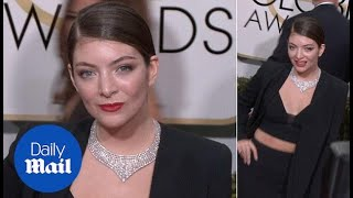 Lorde smiles and smoulders on the Golden Globes red carpet - Daily Mail