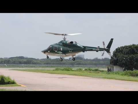 Bell 230 helicopter hovering at Dhaka airport