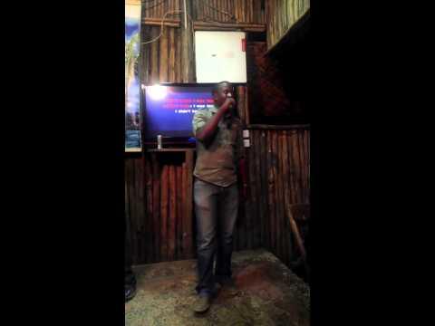 Dj Mwindi and Edward sing karioke at malindi night club