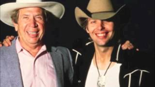 Watch Dwight Yoakam Think Of Me video