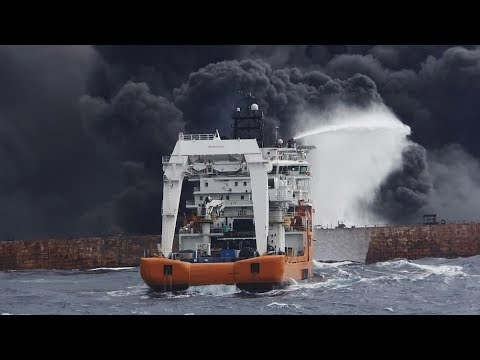 Firefighters struggle with blaze on stricken oil tanker
