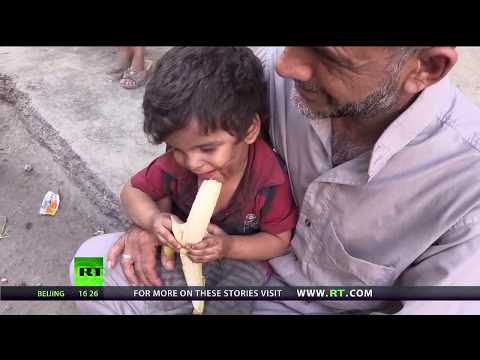 Food For Thought: First taste of fruit for some children after siege in Deir ez-Zor