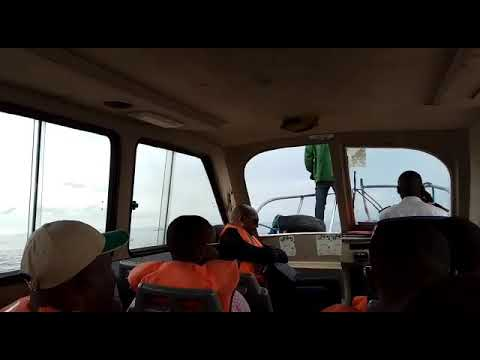 Daddy in a boat crossing Congo River from Brazzaville ton Kinshasa