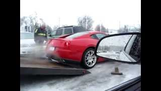 Ferrari wrecked by tow guys