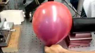 Popping a ballon inside of another balloon with a Ruby Laser