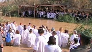 Orthodox Christians celebrate the baptism of Jesus at the Jordan river - no comment