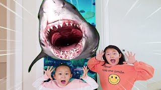 A magical door opens with sharks in a LoveStar home
