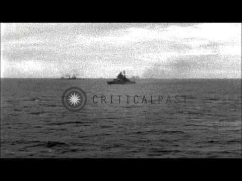 US warships fire and US Navy SBD Dauntless dive bomb Makin Island. HD Stock Footage