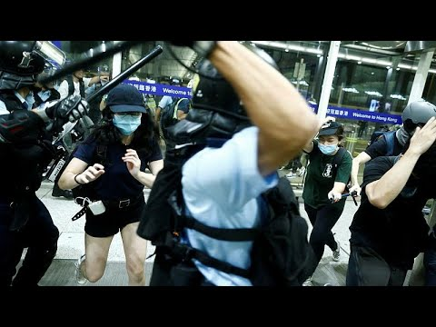 Violent scenes at Hong Kong airport as police and protesters clash