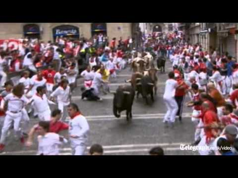 Pamplona bull run: lucky escape for runners as animals run wild in festival