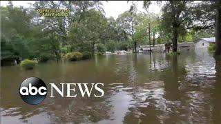 Barry remnants dump more rain, heatwave forms