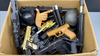 Box of Toy Guns Types  Dragon Head Bead Launcher - Various Weapons - Toy Masks and Equipments