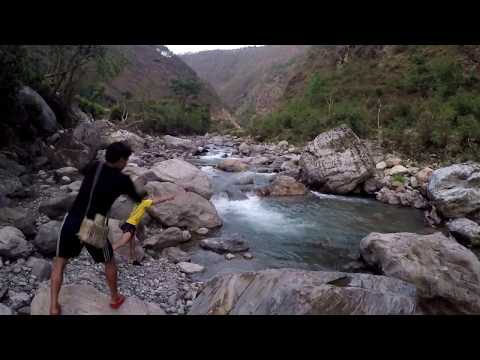 TRADITIONAL WAY OF FISHING HIMALAYAN TROUT IN STREAMY RIVER OF NEPAL...
