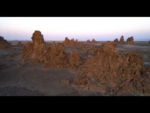 Sunrise Drone Flight over Limestone Chimney Formations at Lake Abbe in Djibouti