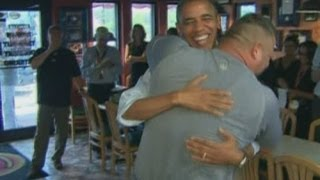 Obama bear hugged by huge pizza shop owner in Florida