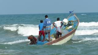 Indian fishing boat gets in to the sea