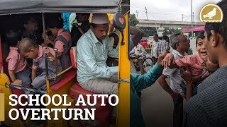 Two school kids hurt as auto overturns at Nampally