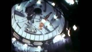 NASA astronauts performing gymnastics on board of the Skylab