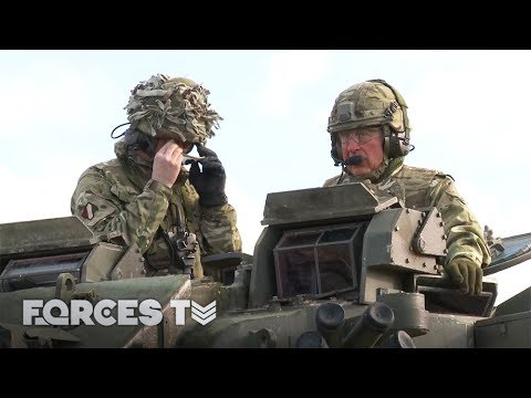 Prince Charles Drives A Tank And Makes Friends With A Military Mascot | Forces TV