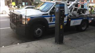 NEWER NYPD TRAFFIC DIVISION TOW TRUCKS PICKING UP ILLEGALLY PARKED CAR ON 10TH AVE. IN MANHATTAN.