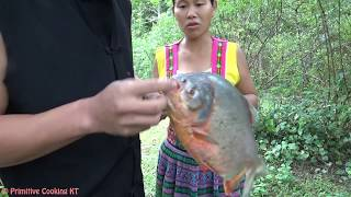 Primitive Technology - catch big fish by primitive skills and cooking fish - eating delicious