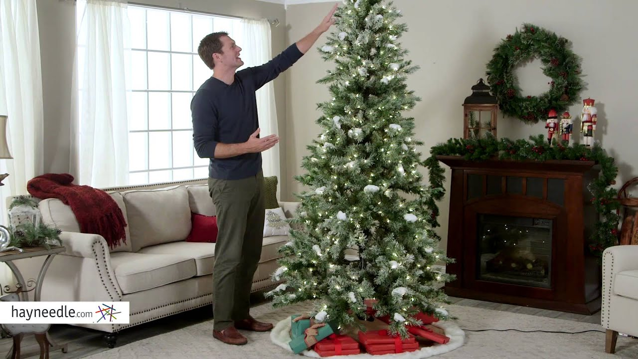 flocked monteray pine pre lit christmas tree with snow clumps product review video youtube