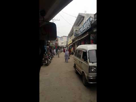 Drive through kotli bazaar azad kashmir on rikshaw / chingchi