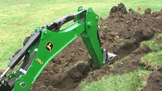 John Deere 1025R 260 backhoe Dig Moat (trench) for our Princess