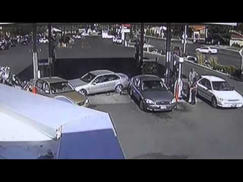 Woman Runs Car Into Gas Pump