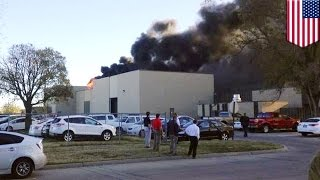 Plane crashed into a building at a Kansas airport, killing four people