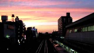 夕焼けと通勤電車 JR西川口駅 Evening glow and commuter train JR Nishi-Kawaguchi Station