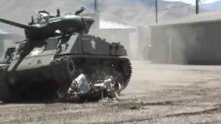 Tank Crushes Two Cars