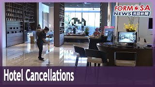 Hotels hit by wave of cancellations as COVID caution grows