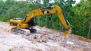 Caterpillar 320D with Hydraulic breaker Breaking limestone on Road Construction