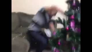 Funny : A man hit his wife with a Xmas tree after she teased him with popcorn throws