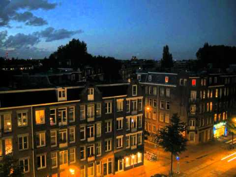 Amsterdam Street, - A view of the streets and coffee shops as night draws in