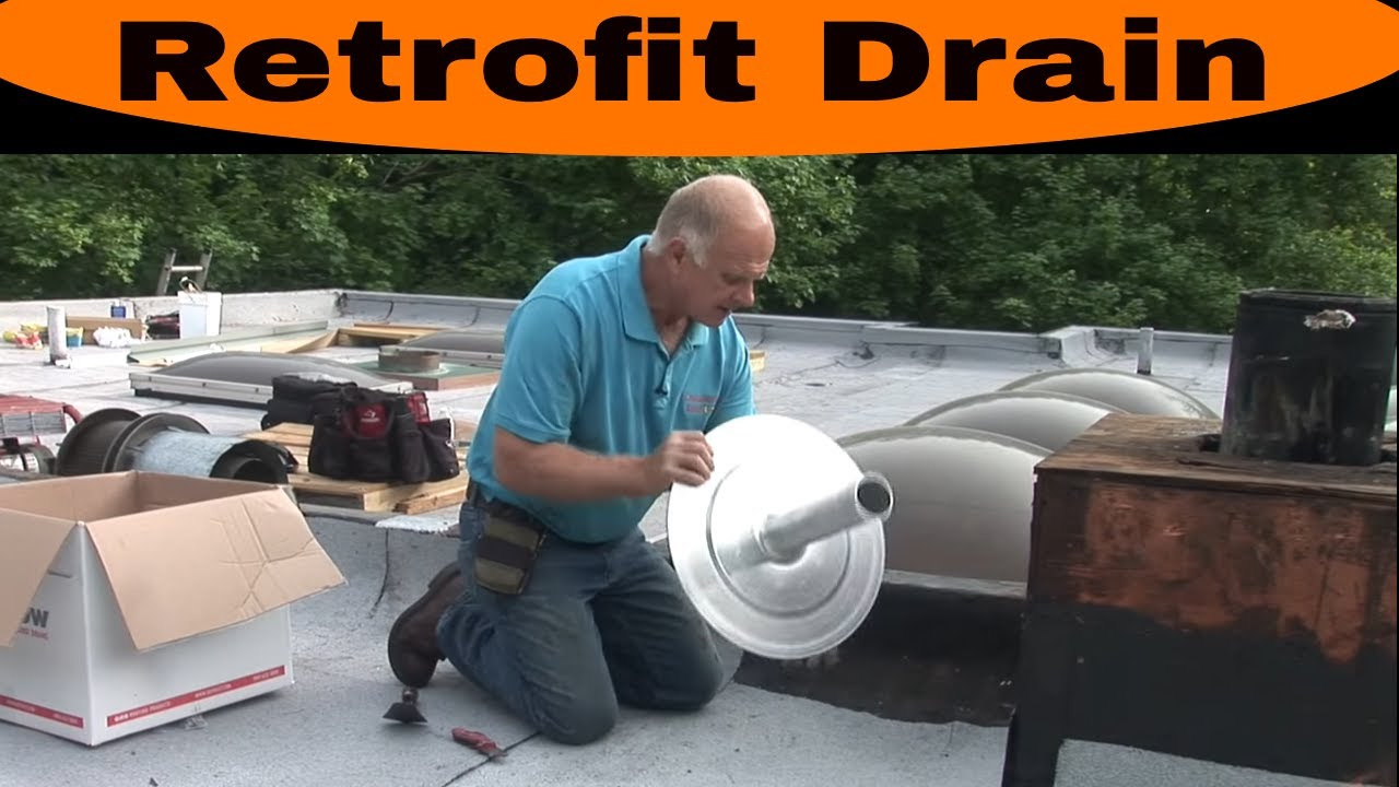 Installing A Retrofit Drain On A Commercial Roof Youtube