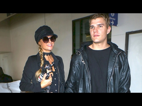 paris hilton and her new man actor chris zylka arrive in. Black Bedroom Furniture Sets. Home Design Ideas