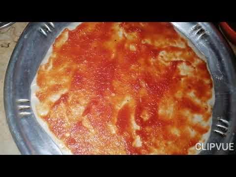 صورة  طريقة عمل البيتزا ابسط طريقة لعمل البيتزا في المنزل وبدون تكاليف طريقة عمل البيتزا من يوتيوب