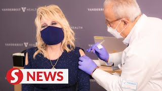 Dolly Parton gets first dose of Covid-19 vaccine she helped fund