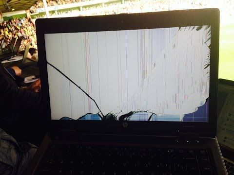 Gareth McAuley apologises after his clearance breaks a West Bromwich Albion laptop in the press box