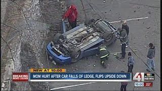 Driver severely hurt after car falls off retaining wall in Kansas City