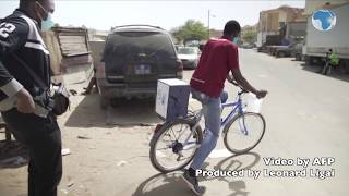 Senegal student cleans up on his modified hand-sanitizer mobigel bicycle