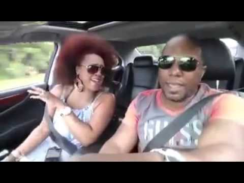 "Couple in car singing ""If it's love"" by Kem & Chrisette Michelle"