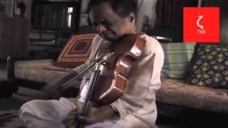 Balamuralikrishna plays violin at home.
