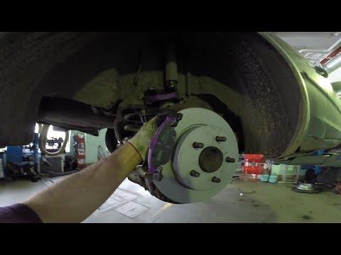 Замена задних колодок, тормозных дисков  и троса ручника Форд Фокус 2