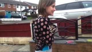 Girl throws water over her head for Red Nose Day
